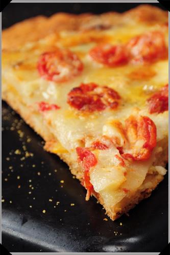 Cheese and potato pizza slice