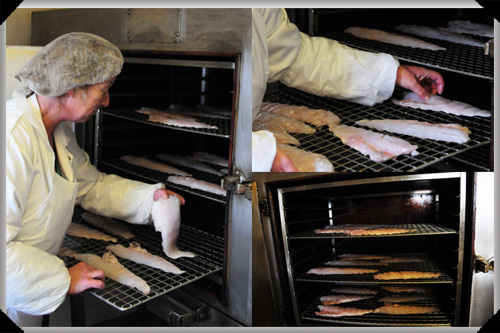 Sally Barnes places fish in the kiln
