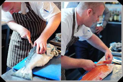 Sean Smith fillets fish at the Cliff Town House