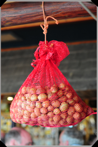 Hanging bag of potatoes